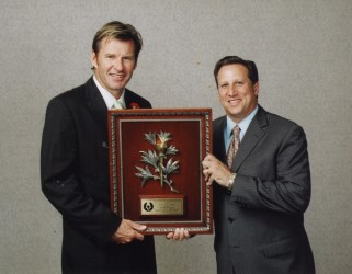 2005 Gold Tee winner Nick Faldo receives his award from former MGWA President Bruce Beck