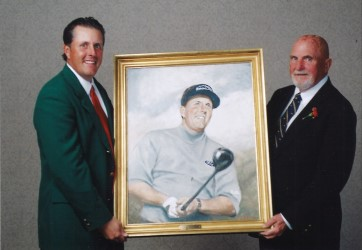 Paul Dillon presents his painting to Phil Mickelson