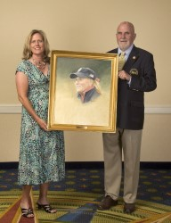 Artist Paul Dillon presents Betsy King with her portrait