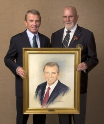 Tim Finchem accepts his portrait from artist Paul Dillon