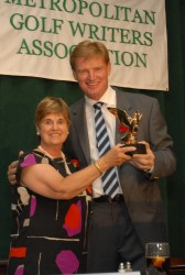 Former MGWA President Patricia Norton presents the 2011 Winnie Palmer Award to Ernie Els