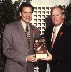 Johnny Miller accepts the 1996 Gold Tee Award from MGWA member Jim Nantz