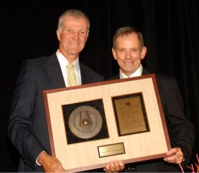 MGWA member Al Small presents the 2009 Distinguished Service Award to Gene Westmoreland